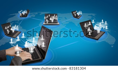 Several laptop computers connected in a social network Royalty-Free Stock Photo #83181304