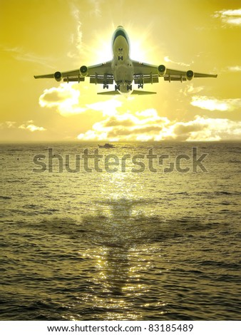 Sunset and airplane fly over ocean