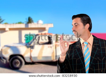 car used salesperson selling old car as brand new  typical topic salesman with hand ok gesture [Photo Illustration] #83218930