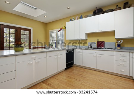 Kitchen in home with skylight near eating area #83241574