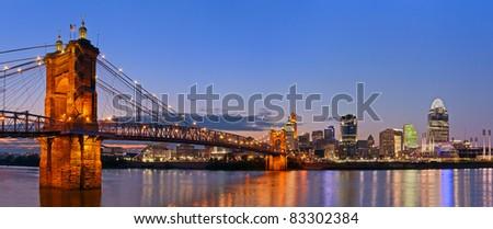 Cincinnati skyline panorama. Image of Cincinnati and John A. Roebling suspension bridge at twilight.