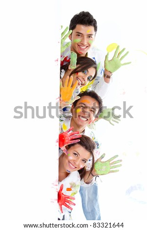Group of painters with paint leaning out from a banner #83321644