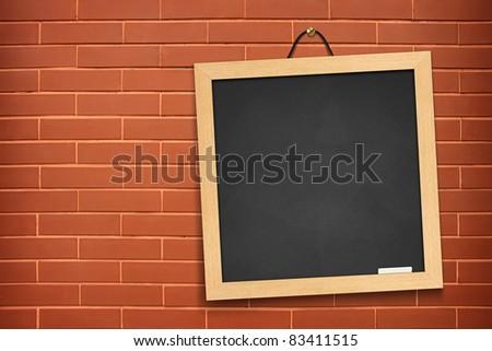 blackboard on orange wall background