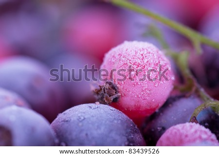 Macro view of frozen berries: blackcurrant, redcurrant, blueberry Royalty-Free Stock Photo #83439526