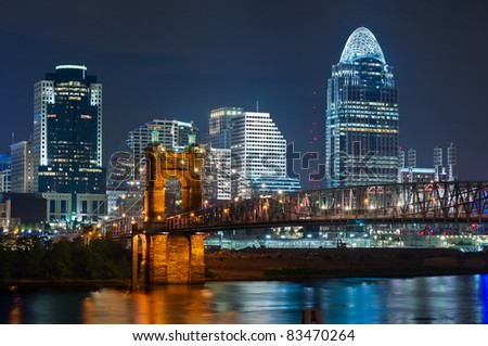 Cincinnati skyline. Image of Cincinnati and John A. Roebling suspension bridge at night.