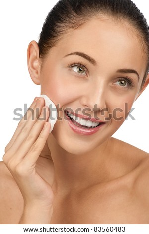 Portrait of young beautiful woman with cotton swab cleaning her face #83560483