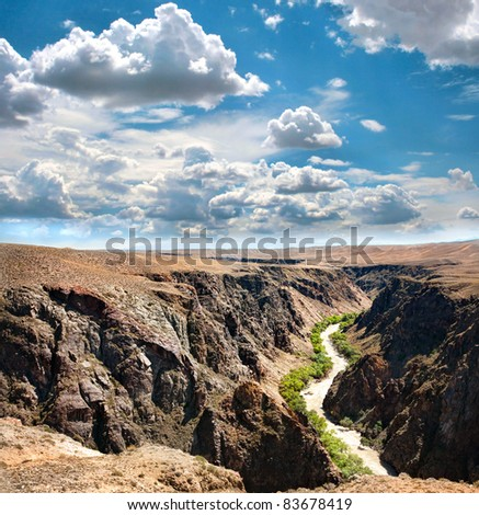 Beautiful river in Charyn canyon and blue sky with clouds in Kazakhstan #83678419