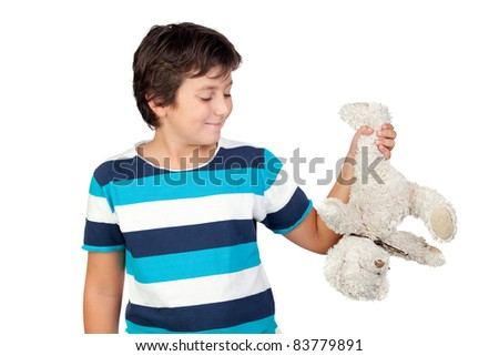Adorable boy picking up a teddy bear isolated on white background #83779891