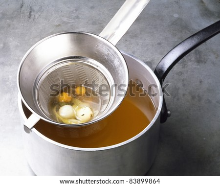 Passing the vegetables through a sieve