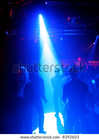 Dancing people in an underground club #8392603
