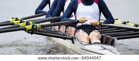 Rowing team at the start of a regatta Royalty-Free Stock Photo #84044047
