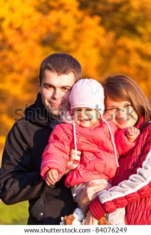 Photo of a happy family enjoying a autumn day at nature