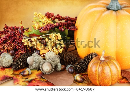 Beautiful autumn display with acorns, leaves and pumpkins.