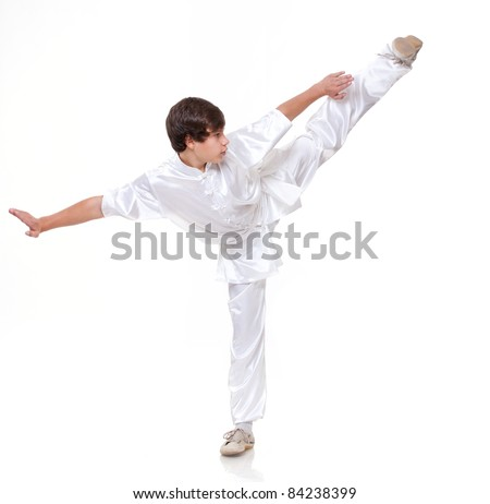 Young boy in kimono practising martial arts on the white background #84238399