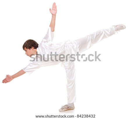 Young boy in kimono practising martial arts on the white background #84238432