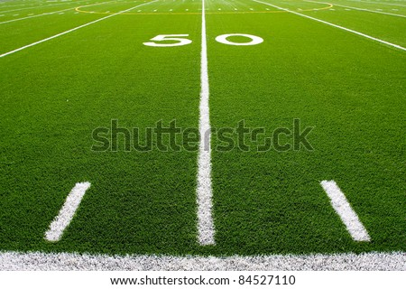 Fifty Yard Line of a Football Field with hashmarks in the foreground #84527110