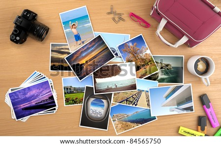 lots of photos spread on a desk with camera and other objects, images can be easily replaced with your own content. all pictures are made by me, some can be found on my portfolio.