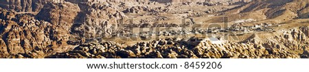 Panoramic landscape of arabic village in  Petra - Nabataeans capital city (Al Khazneh) in Jordan. Banner format. Early morning. #8459206
