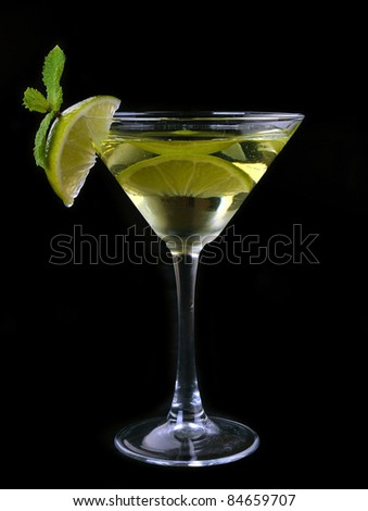 Martini cocktail with lime in the black #84659707
