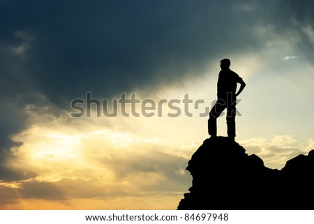 Man on peak of mountain. Conceptual design. #84697948