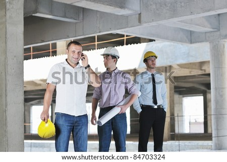 Team of business people in group, architect and engeneer  on construciton site check documents and business workflow on new building #84703324