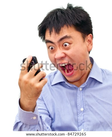 Isolation photo of a crazy angry asian man yelling at his cellphone #84729265