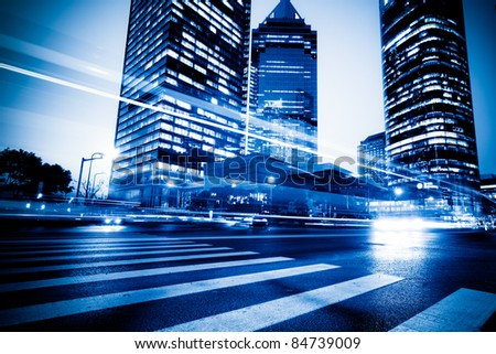 the light trails on the modern building background in shanghai china. #84739009