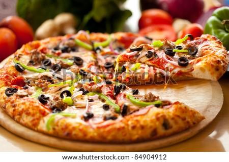 Supreme Pizza lifted slice 1