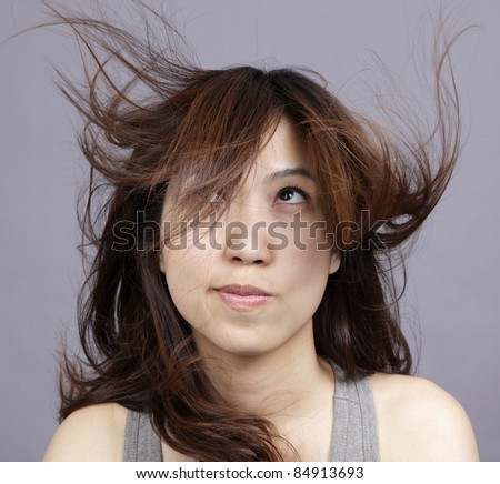 The hair of girl has floated by wind. #84913693