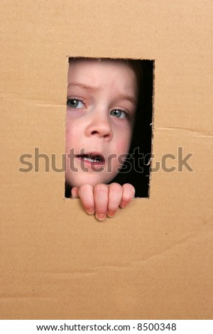 young girl looking from brown carton box #8500348