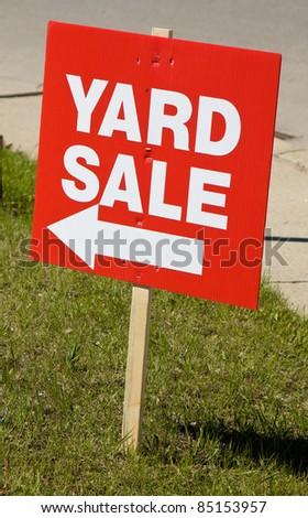 Yard sale sign on lawn