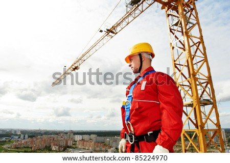 builder worker in uniform with safety belt at construction site #85224970