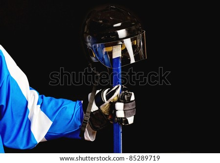 Picture of hockey helmet on hockey player stick