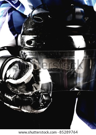 Picture of hockey helmet in hockey player hands