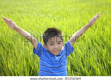 Portrait of happy child in the green rice fields #85356364