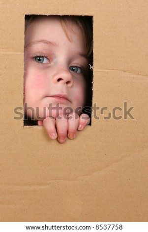young girl looking from brown carton box #8537758