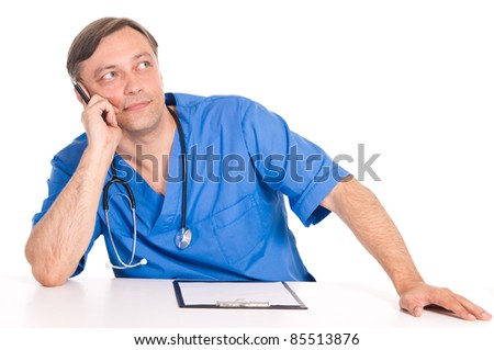 cute doctor in blue posing at table #85513876