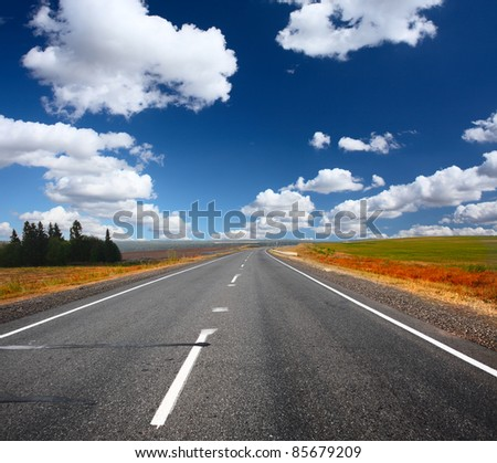 Asphalt road and blue sky with clouds #85679209