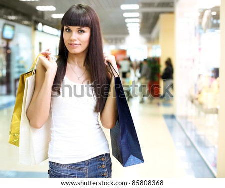 Young girl in a shop buying clothes #85808368