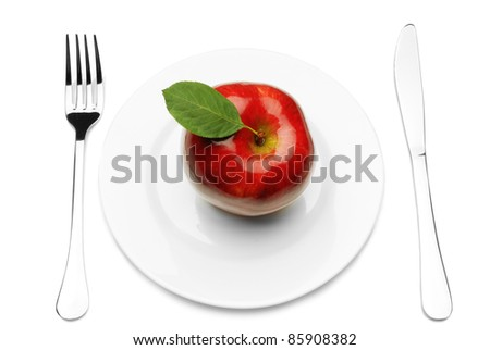 Red apple on white plate with knife and fork, #85908382