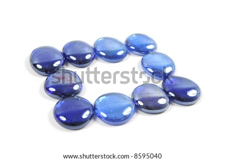 Blue glass stones isolated on a white background. #8595040