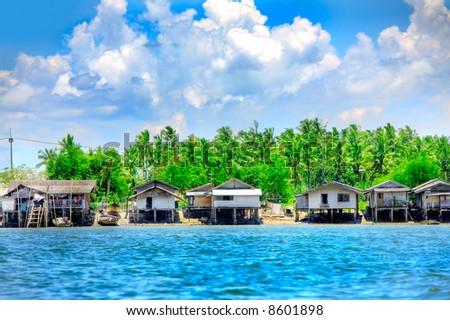 Run down shacks in seaside tropical paradise #8601898