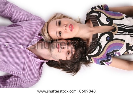 girl and boy lie on the the white #8609848