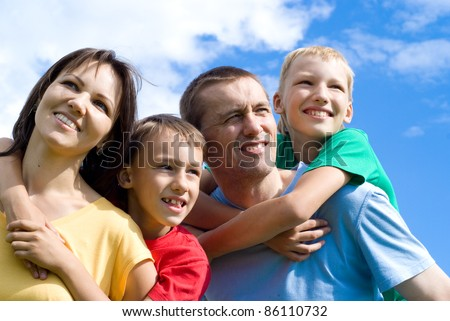 portrait of a cute family on a sky background #86110732