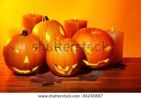 Halloween pumpkin with candles, warm autumn holiday background, traditional jack-o-lantern, night party decoration #86240887