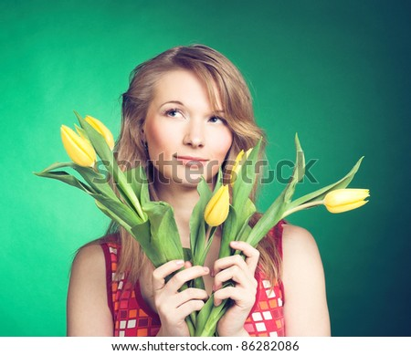 Portrait of young woman with yellow tulips #86282086