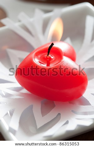 Red heart candle on white paper snowflake #86315053
