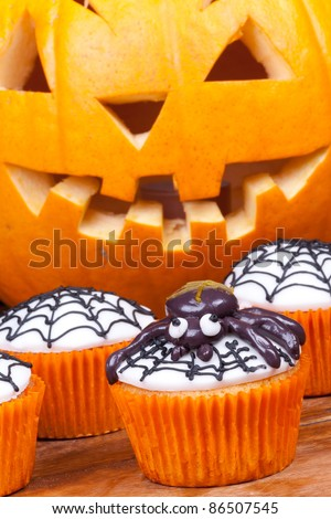 halloween cupcakes with spider and web vertical picture.