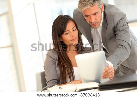 Business presentation on electronic tablet #87096413