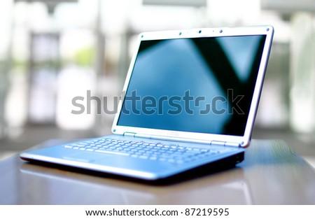 thin laptop on office desk #87219595